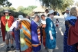 Maasai people dressing us in traditional garb